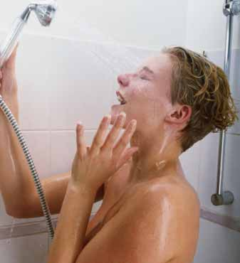 Teenage boy takign shower